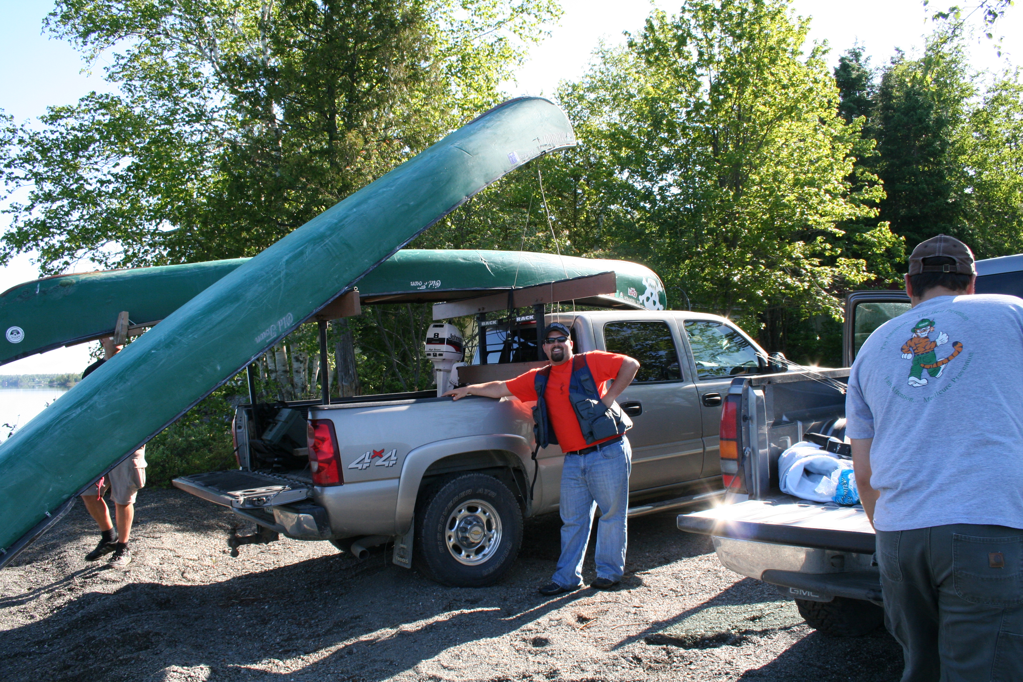 JRod and his sweet hat. Unloading the Canoes
